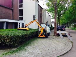 Snoeien hagen woningbouwvereniging